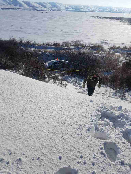 Assessing car buried in snow