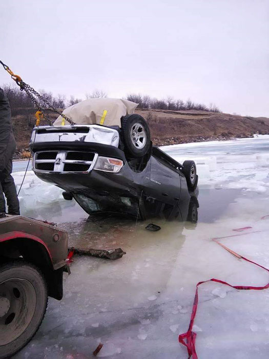 Truck successfully recovered from frozen lake