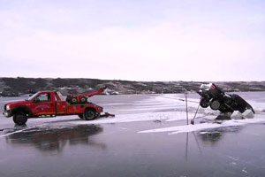 Ice fishing gone wrong! Pulling truck out of frozen lake