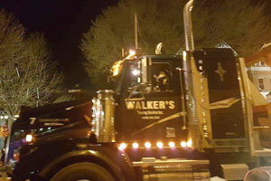 Tow truck in a night parade
